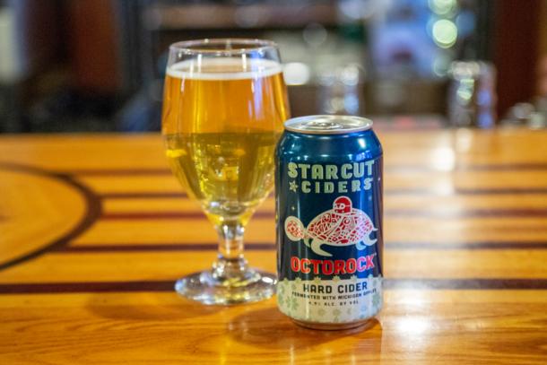 Starcut Octorock Cider can & in a glass